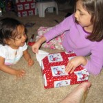 Abigail opening Hannah's present